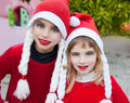 Christmas santa costumer kid girls smiling Royalty Free Stock Images