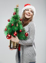 Christmas santa hat isolated woman portrait female smiling model hold green tree Royalty Free Stock Photos