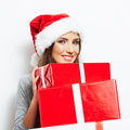 Christmas santa hat isolated woman portrait hold christmas gift smiling happy girl on white background Royalty Free Stock Photos