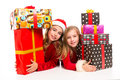 Christmas santa kid girls with many gifts stacked isolated on white Royalty Free Stock Photos