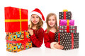 Christmas santa kid girls with many gifts stacked isolated on white Stock Images