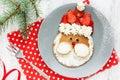 Christmas Santa pancake with strawberry for kid breakfast Royalty Free Stock Photo