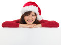 Christmas santa woman showing blank billboard sign smiling cute is empty asian chinese japanese young female model in red Royalty Free Stock Photos