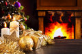 Christmas scene with fireplace and christmas tree in the backgro decorations a gift candles front of a a fire is burning stockings Royalty Free Stock Photo