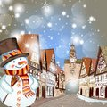 Christmas scene with houses in snow and cute  snowman Royalty Free Stock Photo