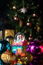Christmas scene with tree, lights and snow globe. Selective focus on black background Royalty Free Stock Photo