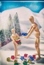 Christmas Scene with wooden mannequin Royalty Free Stock Photo