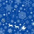 Christmas seamless blue pattern with snowflakes and xmas symbols on background Stock Images