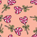 Christmas seamless pattern hand-drawn. New Year candy on a pink background.Happy new year