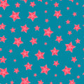 Christmas seamless pattern with red stars over blue Royalty Free Stock Photos
