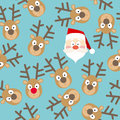 Christmas Seamless Pattern with Santa Claus and Deers Faces in Flat Style Royalty Free Stock Photo