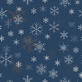 Christmas seamless pattern with snowflakes. Blue background for