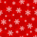 Christmas seamless pattern with snowflakes on a red background Royalty Free Stock Photo