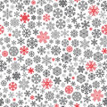 Christmas seamless pattern from snowflakes red and black on white background Stock Photos