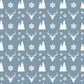 Christmas seamless pattern with white deers, houses, fir trees, snowflakes and stars on blue background. Royalty Free Stock Photo
