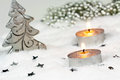 Christmas season background with candles in snow Stock Photography