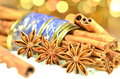 Christmas season cinnamon sticks anise stars on bokeh background Stock Photos
