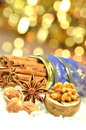 Christmas season cinnamon sticks anise stars and walnut star nuts on bokeh background Royalty Free Stock Photo