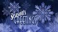Christmas Season`s Greetings holiday message with snowflake orna