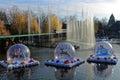 Christmas season snow globes on lake in Theme Park Royalty Free Stock Photo