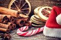 Christmas setting with festive spices and candy cane in brown tone Royalty Free Stock Images