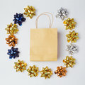 Christmas shopping bag with bows and stars on white background. Royalty Free Stock Photo
