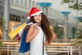 Christmas shopping beautiful happy girl with bags credit card in mall Stock Images