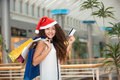 Christmas shopping beautiful happy girl with credit card in mall bags Stock Photos