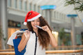 Christmas shopping beautiful happy girl with credit card in mall bags Royalty Free Stock Photo