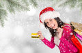 Christmas shopping happy young girl with shopping bags winter theme Stock Image