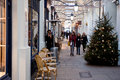 Christmas shopping people stroll in the royal opera arcade in london on november the arcade was the first covered street in Royalty Free Stock Images