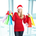 Christmas shopping santa girl Stock Image