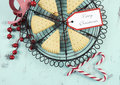 Christmas shortbread traditional triangle shape cookies on vintage baking rack with festive decorations on recycled blue wood Royalty Free Stock Images