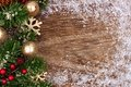 Christmas side border with gold ornaments, branches and snow frame Royalty Free Stock Photo