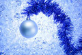 Christmas silver bauble on blue winter ice Stock Image