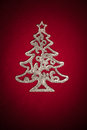 Christmas silver tree on red cloth Royalty Free Stock Photography