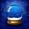 Christmas Snow globe on blue background Royalty Free Stock Photo