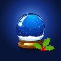 Christmas snow globe and holly berry Royalty Free Stock Photo