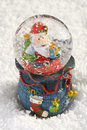 Christmas snow globe with santa claus decoration on Royalty Free Stock Photo