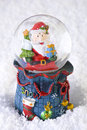 Christmas snow globe with santa claus decoration on Stock Photography