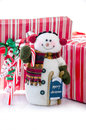 Christmas snow man a cute snowman with red and white packages candy and a little sled Stock Photos