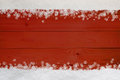 Christmas snowflake border on red wood snow and snowflakes at top and bottom of planking Stock Image