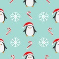 Christmas snowflake candy cane, penguin wearing red santa hat, scarf. Seamless Pattern Decoration. Wrapping paper, textile templat
