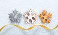 Christmas snowflake cookies on snow Royalty Free Stock Photo