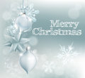 Christmas snowflake and decoration background with merry message silver baubles Royalty Free Stock Image