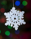 Christmas snowflake ornament with defocused lights Royalty Free Stock Image