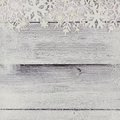 Christmas snowflake top border with snow frame on white wood Royalty Free Stock Photo