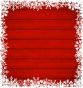 Christmas snowflakes border on wooden background