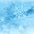 Christmas snowflakes on snow Stock Images