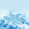 Christmas snowflakes on snow Stock Image